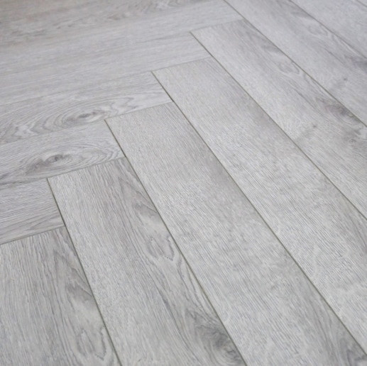 FloorsAndMore - 12mm Herringbone Laminate Flooring - Grey Oak